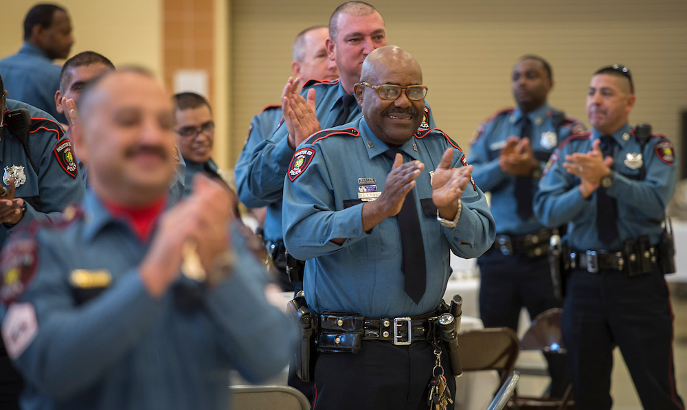 Officers recognize honorees during the Houston ISD Police awards banquet at Thompson Elementary School, August 15, 2014.