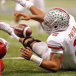 January 4, 2011; New Orleans, LA, USA; Ohio State Buckeyes quarterback Terrelle Pryor (2) fumbles near the goal, wide receiver Dane Sanzenbacher (not pictured) would recover the ball in the endzone for a touchdown during the first quarter of the 2011 Sugar Bowl against the Arkansas Razorbacks at the Louisiana Superdome.  Mandatory Credit: Derick E. Hingle