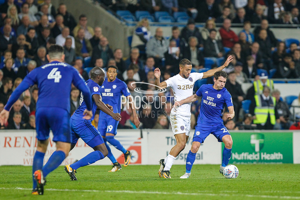 Kemar Roofe of Leeds United challenges Craig Bryson of Cardiff City during the EFL Sky Bet Championship match between Cardiff City and Leeds United at the Cardiff City Stadium, Cardiff, Wales on 26 September 2017. Photo by Andrew Lewis.