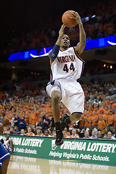 Virginia's Sean Singletary (44) gets air borne in action against Duke.  The University of Virginia Cavaliers beat the #8 ranked Duke University Blue Devils 68-66 in overtime at the John Paul Jones Arena in Charlottesville, VA on February 1, 2007...