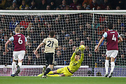 Burnley goalkeeper Nick Pope (1) makes a diving save during the Premier League match between Burnley and Manchester United at Turf Moor, Burnley, England on 28 December 2019.