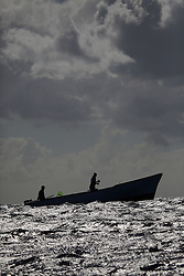 MAURITIUS BLACK RIVER 2MAY13 - Silhouette of artisanal fishermen working in their boat in Black Rivery Bay, Mauritius.<br /> <br /> <br /> <br /> Coastal fishing is in decline due to large, industrial foreign fishing fleets operating in Mauritian waters.<br /> <br /> The Greenpeace ship Esperanza is on patrol in the Indian Ocean documenting fishing activties.<br /> <br /> <br /> <br /> jre/Photo by Jiri Rezac / Greenpeace