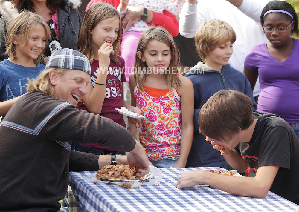 New Hampton, New York - People compete in a pie-eating contest during the celebration of 100 years in business at Soons Orchards and Farm Market  on Oct. 11, 2010.