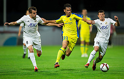 Horvat Lucas Mario of NK Domzale between Jankovic Branislav of FK Cukaricki and Srnic Slavoljub of FK Cukaricki during 1st Leg football match between NK Domzale (SLO) na FC Cukaricki (SRB) in 1st Round of Europe League 2015/2016 Qualifications, on July 2, 2015 in Sports park Domzale,  Slovenia. Photo by Vid Ponikvar / Sportida