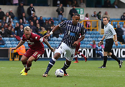 Millwall's Liam Trotter vies for possession with Derby County's Johnny Russell  - Photo mandatory by-line: Robin White/JMP - Tel: Mobile: 07966 386802 14/09/2013 - SPORT - FOOTBALL -  The Den - London - Millwall V Derby County - Sky Bet League Championship
