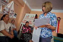 Marina Molchanova, an attorney, meets with locals to talk about their legal issues at the village community center, Bila Tserkva, Ukraine, June 14, 2011. More than half of the worldÕs population, four billion people, live outside the rule of law, with no effective title to property, access to courts or redress for official abuse. The Open Society Justice Initiative is involved in building capacity and developing pilot programs through the use of community-based advocates and paralegals in Sierra Leone, Ukraine and Indonesia. The pilot programs, which combine education with grassroots tools to provide concrete solutions to instances of injustice, help give poor people some measure of control over their lives.