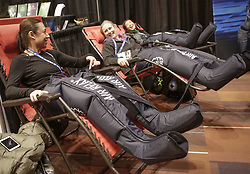 November 18, 2018 - Vancouver, Canada - People experience a compression leg massager while attending the Canfitpro Vancouver Fitness Expo, a four-day event which brings together fitness professionals and consumers to check out the latest science, trends and products in the fitness industry. (Credit Image: © Liang Sen/Xinhua via ZUMA Wire)