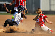 9 OCT. 2010 -- ARNOLD, Mo. -- Cor Jesu Academy shortstop Sarah Morris (19) lets the softball get past her and into centerfield while trying to tag Oakville High School base runner Janelle Hackmann (7) during the Chargers' game against Oakville High School at the MSHSAA Class 4 Distirct 2 softball championships at Fox High School in Arnold, Mo. Saturday, Oct. 9, 2010. The Tigers won the game, 3-0, the advance in the playoffs. Image © copyright 2010 Sid Hastings.