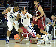 Villanova's Darryl Reynolds (45) and Jalen Brunson (1) are tripped up by IUP's Brandon Spain (3) in the first half Saturday, November 5, 2016 at the Wells Fargo Center in Philadelphia, Pennsylvania. (WILLIAM THOMAS CAIN / For The Philadelphia Inquirer)