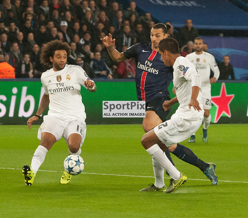 Zlatan Ibrahimović (Paris Saint-Germain) is thwarted by the Real Madrid defence