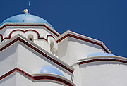 Greece, Santorini, Oia, Typical blue domed roof and whitewashed walls of a Greek Orthodox Church