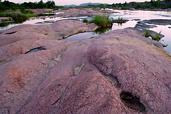 Stock photo of the pink granite boulders along the Llano River in the Texas Hill Country at sunset