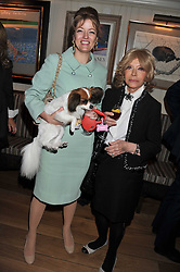 Left to right, PETRONELLA WYATT and her mother LADY WYATT with their dog Mini at the 10th anniversary of George in association with The Dog's Trust held at George, 87-88 Mount Street, Mayfair, London on 13th September 2011.