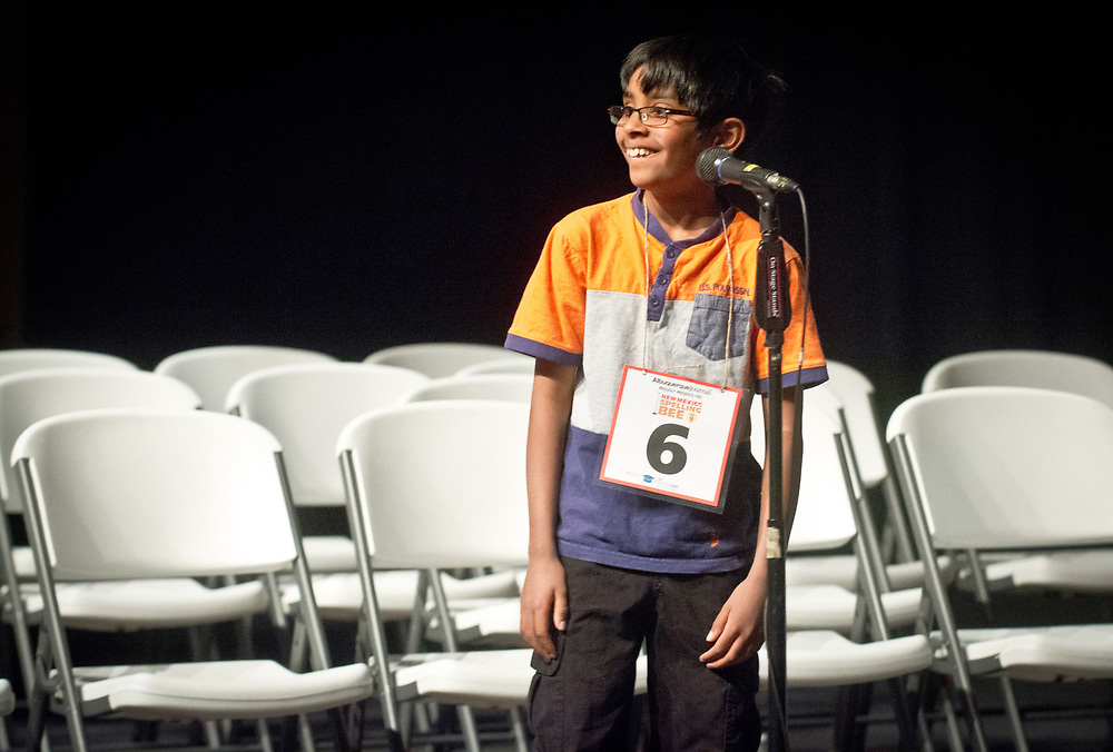 Akilan Sankaran, center, a Manzano Day School 4th grader, smiles after spelling his last word to win the 2017 New Mexico Spelling Bee at Sandia Prep, Saturday, March 18, 2017. (Marla Brose/Albuquerque Journal)