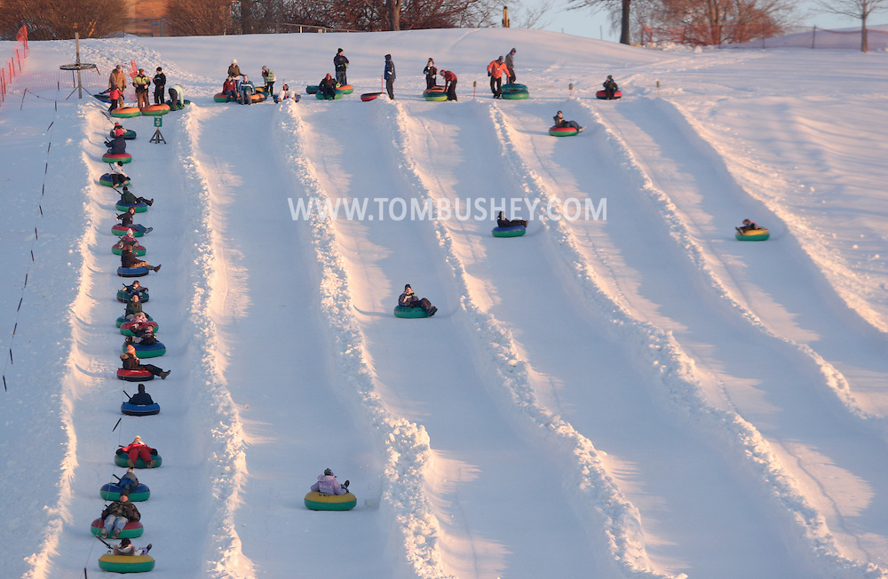 Hamptonburgh, NY - People slide down the snow tubing hill at Thomas Bull Memorial Park on Feb. 16, 2008.