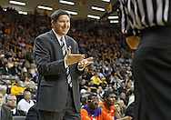 November 29, 2011: Clemson Tigers head coach Brad Brownwell talks with an official during the first half of the NCAA basketball game between the Clemson Tigers and the Iowa Hawkeyes at Carver-Hawkeye Arena in Iowa City, Iowa on Tuesday, November 29, 2011. Clemson defeated Iowa 71-55 in the Big Ten-ACC Challenge game.