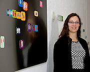 Artist with interactive magnets that were part of her Master of Fine Arts Exhibition at the University of Wisconsin, Deartment of Art