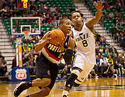 Damian Lilliard, left, drives the lane against Randy Foye during a preseason game at EnergySolutions Arena in Salt Lake City, Thursday, Oct. 25, 2012.