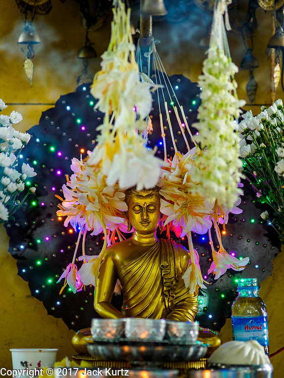 24 NOVEMBER 2017 - YANGON, MYANMAR: A Buddhist shrine on a street in Yangon.   PHOTO BY JACK KURTZ