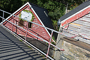 Diagonal lines and angular patterns with peeling paintwork on seaside huts, on 13th September 2018, in Barmouth, Gwynedd, Wales.