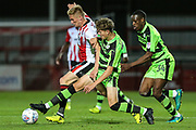 Forest Green Rovers Jordan Stevens(35) tackles Cheltenham Town's Taylor Moore(28) during the EFL Trophy match between Cheltenham Town and Forest Green Rovers at Whaddon Road, Cheltenham, England on 3 October 2017. Photo by Shane Healey.