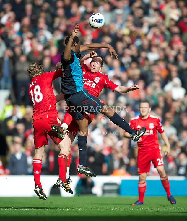 LIVERPOOL, ENGLAND - Saturday, March 3, 2012: Liverpool's Dirk Kuyt and Charlie Adam challenge Arsenal's Abou Diaby during the Premiership match at Anfield. (Pic by David Rawcliffe/Propaganda)