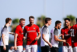 Taylor Moore and Nathan Baker of Bristol City during the 2nd leg of the match after the previous day's game was abandoned at half time due to extreme weather - Rogan/JMP - 14/07/2019 - IMG Academy, Bradenton - Florida, USA - Bristol City v Derby County - Pre-Season Tour Day 3.