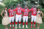 KO OLINA - FEBRUARY 10:  Buffalo Bills 2005 NFL Pro Bowl AFC All-Stars (left to right: Terrence McGee #24, Sam Adams #95, Nate Clements #22, and Takeo Spikes #51) pose with Hawaiian Hula girls for their 2005 NFL Pro Bowl team photo on February 10, 2005 in Ko Olina, Hawaii. ©Paul Anthony Spinelli