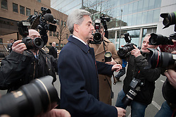© Licensed to London News Pictures. 02/03/2012. London, UK. Liberal Democrat MP CHRIS HUHNE surrounded by photographers as he leavies Southwark Crown Court in London on March 2nd, 2012 where he faced charges of perverting the course of justice. Former Energy Secretary CHRIS HUHNE is accused of asking his ex-wife VICKY PRYCE to take speeding points on his behalf in 2003. Photo credit : Ben Cawthra/LNP