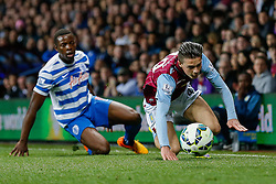 Jack Grealish of Aston Villa (making his first Premier League start) is fouled by Nedum Onuoha of QPR - Photo mandatory by-line: Rogan Thomson/JMP - 07966 386802 - 07/04/2015 - SPORT - FOOTBALL - Birmingham, England - Villa Park - Aston Villa v Queens Park Rangers - Barclays Premier League.