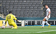 Picture by David Horn/Focus Images Ltd +44 7545 970036.29/09/2012.Charlie Macdonald of Milton Keynes Dons scores the opening goal during the npower League 1 match at stadium:mk, Milton Keynes.