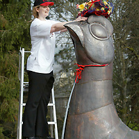 Lynne Grant of the Famous Grouse Experience in Crieff putting the finishing touches to the easter bonnet on the giant copper grouse which sits at the entrance to the distillery<br />