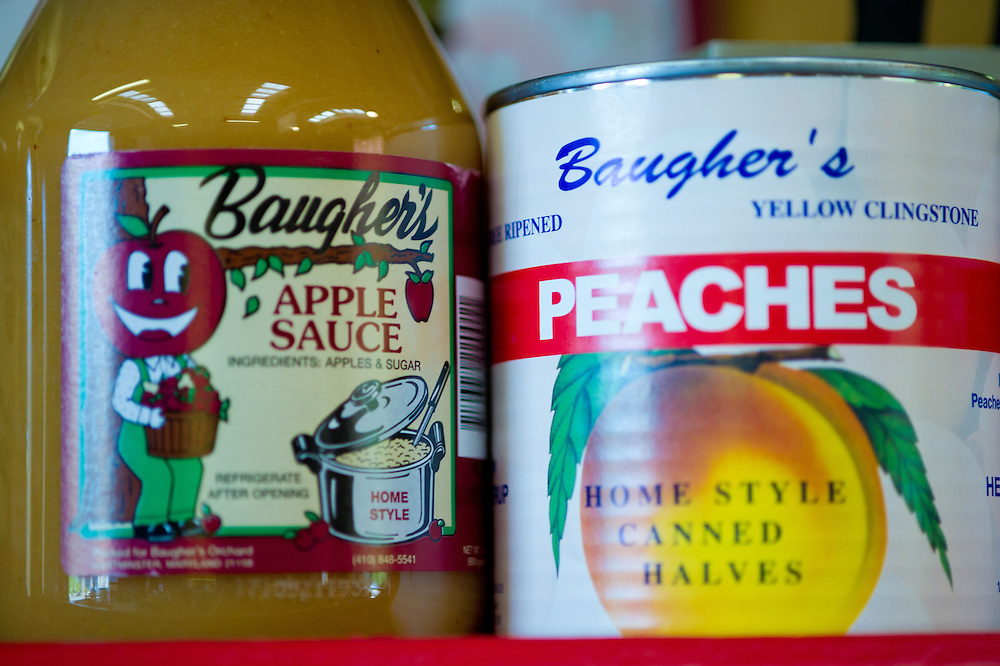Canned goods, apple sauce and peaches for sale at a farmer's market