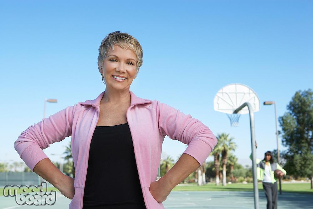 Senior women on outdoor basketball court, portrait