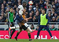 Football - 2019 / 2020 Premier League - Tottenham Hotspur vs. Wolverhampton Wanderers<br /> <br /> Davinson Sanchez (Tottenham FC)  heads cllear over Daniel Podence (Wolverhampton Wanderers) at The Tottenham Hotspur Stadium.<br /> <br /> COLORSPORT/DANIEL BEARHAM