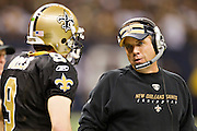 NEW ORLEANS, LA - DECEMBER 26:   Drew Brees #9 and Head Coach Sean Payton of the New Orleans Saints talk on the sidelines during a game against the Atlanta Falcons at Mercedes-Benz Superdome on December 26, 2011 in New Orleans, Louisiana.  The Saints defeated the Falcons 45-16.  (Photo by Wesley Hitt/Getty Images) *** Local Caption *** Drew Brees; Sean Payton