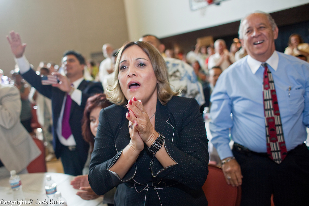 "19 JUNE 2009 -- PHOENIX, AZ: Priscilla Macias (CQ) applauds Rev Al Sharpton at Pilgrim Rest church in Phoenix Friday. Rev. Al Sharpton is in Phoenix Friday to protest the high profile ""crime suppression"" sweeps conducted by the Sheriff's Department. Critics contend the sweeps use racial profiling to target Hispanics. PHOTO BY JACK KURTZ"