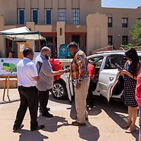 Battered Family Services Director, Willard Eastman, center, and his team receive a new 2018 Toyota RAV 4 XL Hybrid from the Toyota company at the McKinley County Courthouse Square Tuesday morning, as they are the charity that was picked from the voters of the Wyland National Mayor's Challenge for Water Conservation.