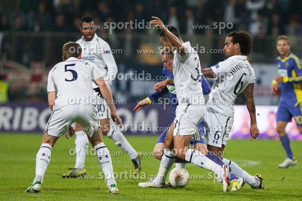 Jan Vertonghen #5 of Tottenham, Steven Caulker #33 of Tottenham , Tom Huddlestone #6 of Tottenham and Robert Beric #32 of Maribor during football match between NK Maribor (SLO) and Tottenham Hotspur FC (UK) in 3rd Round of Group Stage of UEFA Europa league 2013, on October 25, 2012 in Stadium Ljudski vrt, Maribor, Slovenia. (Photo By Gregor Krajncic / Sportida)