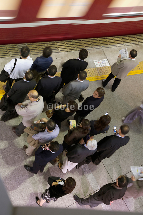 overhead view of commuters waiting for the next train