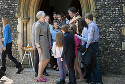 © Licensed to London News Pictures.16/04/2017.Reading, UK. Prime Minister Theresa May is surround by members of the congregation as leaves church with her husband Philip after attending an Easter Sunday service in her constituency.Photo credit: Peter Macdiarmid/LNP