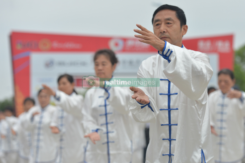 September 20, 2017 - Changde, China - Demonstration of a traditional Tai chi ahead of the start to the second stage of the 2017 Tour of China 2, the 97.6km Changde Lixiang Circuit Race. .On Wednesday, 20 September 2017, in Lixian County, Changde City, Hunan Province, China. (Credit Image: © Artur Widak/NurPhoto via ZUMA Press)