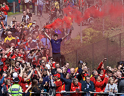 LIVERPOOL, ENGLAND - Sunday, May 12, 2019: A Liverpool supporter waits for the team bus to arrive with a red smoke bomb before the final FA Premier League match of the season between Liverpool FC and Wolverhampton Wanderers FC at Anfield. (Pic by David Rawcliffe/Propaganda)