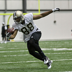 July 27, 2012; Metairie, LA, USA; New Orleans Saints wide receiver Nick Toon (88) makes a one handed catch during training camp at the team's indoor practice facility. Mandatory Credit: Derick E. Hingle-US PRESSWIRE