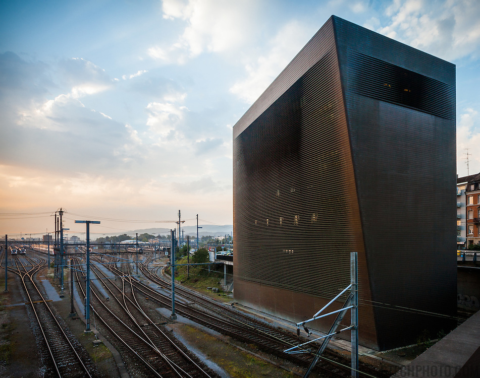 "Basel's central railway signal box affectionately known as the ""Copper Tower"". Design by architects Jacques Herzog and Pierre de Meuron. The copper coiling of the building acts as a Faraday cage protecting the sensitive electronic equipment of the signal box from lightning strikes."