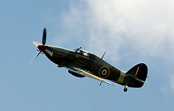 Battle of Britain Memorial flight fly past by a Hurricane MkIIc  at the The first Annual Lytham 1940s Weekend held to celebrate the 70th anniversary of the battle of Britain and raise funds for a new Fighter and Bomber Command Memorial to be erected in Lytham. 21 August 2010 Images © Paul David Drabble..