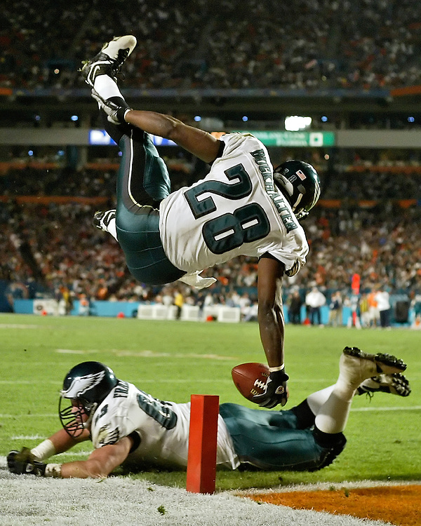 Philadelphia Eagles running back Correll Buckhalter (28) leaps into the end-zone over Eagles center Hank Fraley (63) Monday, December, 15, 2003. The Philadelphia Eagles defeated the Miami Dolphins 34-27 at Pro Player Stadium in Miami, FL.