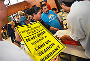 Volunteers from Keep Tucson Together and attorney Margo Cowan provide legal assistance to persons effected by changes to DACA, or Deferred Action Childhood Arrival, which provided legal protection to those brought into the United States illegally as children, at a clinic at Pueblo Magnet High School, Tucson, Arizona, USA. Maria Arguello, center, fears that she will be targeted by law enforcement at her residence.