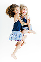 caucasian little girl cheer up hug sister isolated studio on white background