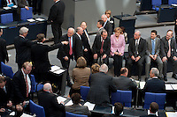 13 FEB 2009, BERLIN/GERMANY:<br /> Zwischen zwei namentlichen Abstimmungen gibt es eine Abstimmung durch Aufstehen oder Hinsetzen, da einige Abgeordnete bereits an der Wahlurne auf die namentlich Abstimmung warten, setzen sie sich auf den Stengrafentisch und den Tisch mit der Urne. Links: Guido Westerwelle, FDP Bundesvorsitzender, Mitte: Angela Merkel, CDU, Budneskanzlerin, Abstimmungen zum zweiten Konjunkturpaket zur Sicherung von Beschaeftigung und Stabilitaet in Deutschland, Plenum, Deutscher Bundestag<br /> IMAGE: 20090213-01-114